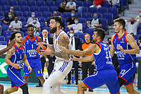 30th September 2021; Madrid, Spain:  Euroleague Basketball, Real Madrid versus Anadolu Efes Istanbul;  Vincent Poirier of team Real Madrid surrounded by Rodrigue Beaubois, Shane Larkin, James Anderson and Krunoslav Simon of team Anadolu Efes and during the Matchday 1 between Real Madrid and Anadolu Efes Istanbul