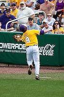 LSU Tigers first baseman Mason Katz #8 attempts to make a catch in foul territory during the NCAA baseball game against the Mississippi State Bulldogs on March 18, 2012 at Alex Box Stadium in Baton Rouge, Louisiana. LSU defeated Mississippi State 4-2. (Andrew Woolley / Four Seam Images).