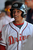 Shortstop Jeremy Rivera (35) of the Greenville Drive smiles after scoring a run in a game against the Augusta GreenJackets on Sunday, June 12, 2016, at Fluor Field at the West End in Greenville, South Carolina. Greenville won, 11-8. (Tom Priddy/Four Seam Images)