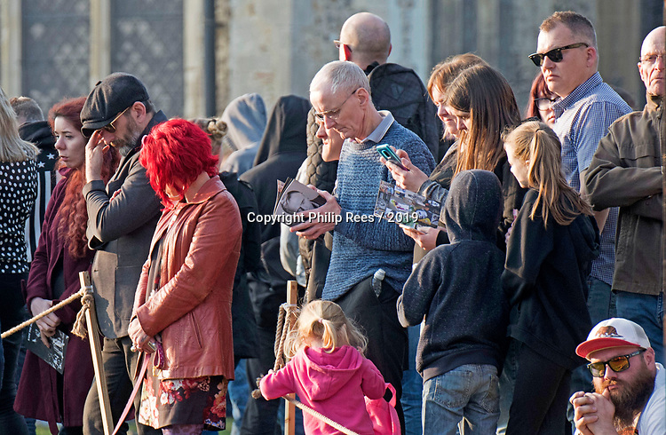 Mourners readiing the order of service of the late Prodigy singer Keith Flint outside St Marys Church in Bocking,  Braintree, Essex today.