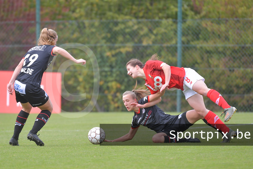 midfielder Lotte De Wilde (19 Zulte-Waregem) , defender Ella Vierendeels (4 Zulte-Waregem) and forward Sanne Schoenmakers (8 Standard) pictured during a female soccer game between Standard Femina de Liege and Dames SV Zulte Waregem on the fifth matchday of the 2020 - 2021 season of Belgian Scooore Womens Super League , saturday 17 th of October 2020  in Angleur , Belgium . PHOTO SPORTPIX.BE | SPP | STIJN AUDOOREN