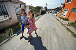"""THIS PHOTO IS AVAILABLE AS A PRINT OR FOR PERSONAL USE. CLICK ON """"ADD TO CART"""" TO SEE PRICING OPTIONS.   Esmeralda and Semirah Redjepi are Roma youth in Suto Orizari, the Macedonian municipality that is Europe's largest Roma settlement. Here the sisters walk to school."""