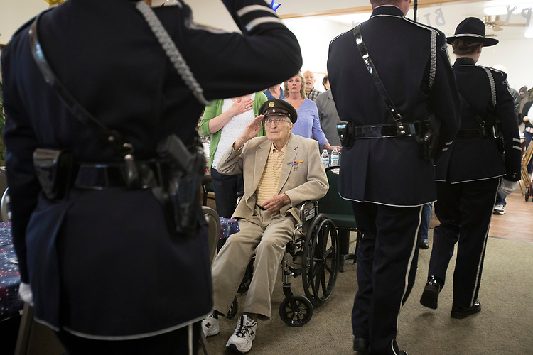 World War II Veteran Ubran Kluthe salutes the Beaverton City Police Department's Color Guard as they depart after presenting the colors for his 98th birthday ceremony at the Elsie Stuhr Center.<br /> Photo by Jaime Valdez