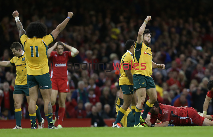 The Australian players Joe Tomane and Adam Ashley-Cooper celebrate at the final whistle after victory over Wales.<br /> Dove Men Series 2014<br /> Wales v Australia<br /> Millennium Stadium<br /> 08.11.14<br /> ©Steve Pope-SPORTINGWALES