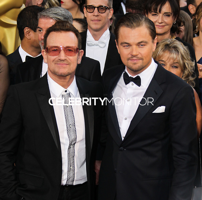 HOLLYWOOD, CA, USA - MARCH 02: Bono, Leonardo DiCaprio at the 86th Annual Academy Awards held at Dolby Theatre on March 2, 2014 in Hollywood, Los Angeles, California, United States. (Photo by Xavier Collin/Celebrity Monitor)