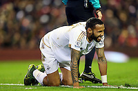 Kyle Bartley feels the pain from a knock during the Barclays Premier League Match between Liverpool and Swansea City played at Anfield, Liverpool on 29th November 2015