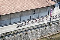 peloton rolling through the town of Borgomanero <br /> <br /> 104th Giro d'Italia 2021 (2.UWT)<br /> Stage 19 from Abbiategrasso to Alpe di Mera (Valsesia)(176km)<br /> <br /> ©kramon