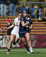 Newton, Massachusetts - February 27, 2018: NCAA Division I. Boston College (white) defeated Navy (blue), 19-14, at Newton Lacrosse Complex.