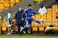 7th February 2021; Molineux Stadium, Wolverhampton, West Midlands, England; English Premier League Football, Wolverhampton Wanderers versus Leicester City; James Justin of Leicester City traps the ball on the wing watched by Brendan Rogers Manager of Leicester City