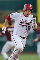 Indiana Hoosiers catcher Kyle Schwarber (10) runs to third base against the Mississippi State Bulldogs during Game 6 of the 2013 Men's College World Series on June 17, 2013 at TD Ameritrade Park in Omaha, Nebraska. The Bulldogs defeated Hoosiers 5-4. (Andrew Woolley/Four Seam Images)