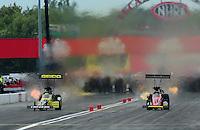 Sept. 5, 2011; Claremont, IN, USA: NHRA top fuel dragster driver Morgan Lucas (left) races alongside Doug Kalitta during the US Nationals at Lucas Oil Raceway. Mandatory Credit: Mark J. Rebilas-