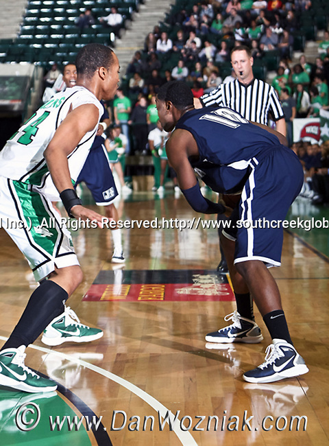 Jackson State Tigers guard Tyrone Hanson (10) is guarded by North Texas Mean Green forward Kedrick Hogans (24) in the game between the Jackson State Tigers and the University of North Texas Mean Green at the North Texas Coliseum,the Super Pit, in Denton, Texas. UNT defeated Jackson 68 to 49