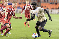 Houston, TX - Friday December 9, 2016: Ema Twumasi (22) 0f the Wake Forest Demon Deacons brings the ball up the field against the Denver Pioneers at the NCAA Men's Soccer Semifinals at BBVA Compass Stadium in Houston Texas.