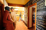 Customers check out the menu printed in chalk on the wall at the Shambala Cafe and Tea House in Crestone, CO. Michael Brands for The New York Times.