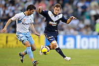MELBOURNE, AUSTRALIA - FEBRUARY 18, 2010: Leigh Broxham from Melbourne Victory chases the ball in the first leg of the A-League Major Semi Final match between the Melbourne Victory and Sydney FC at Etihad Stadium on February 18, 2010 in Melbourne, Australia. Photo Sydney Low www.syd-low.com