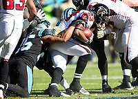 CHARLOTTE, NC - NOVEMBER 17: Brian Hill #23 of the Atlanta Falcons is stopped by Eric Reid #25 of the Carolina Panthers during a game between Atlanta Falcons and Carolina Panthers at Bank of America Stadium on November 17, 2019 in Charlotte, North Carolina.