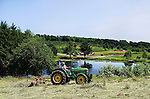 Bethlehem, CT- 03 July 2015-070315CM08-  Country Life Only Please---- A tractor at work at March Farms in Bethlehem on Friday.  Families went to the farms to pick blueberries and cherries, two fruits currently in season.  For current picking conditions you can call the farm at (203) 266-7721. Christopher Massa Republican-American