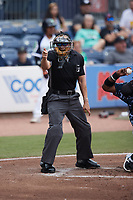 Home plate umpire Dave Martinez makes a strike call during the Triple-A East game between the Jacksonville Jumbo Shrimp and the Gwinnett Stripers at Coolray Field on October 3, 2021 in Lawrenceville, Georgia. (Brian Westerholt/Four Seam Images)