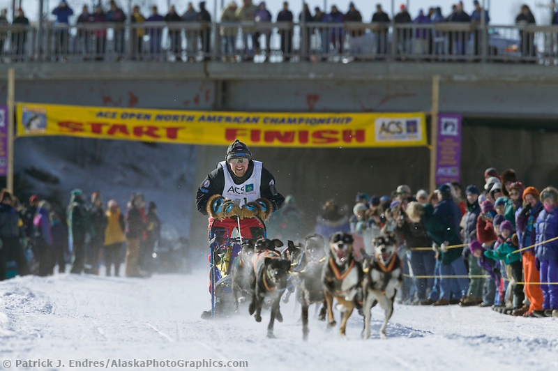Egil Ellis at the start of day three of the oldest continuously run sled dog race in the world, the 2003 Open North American Sled dog championships which start on the Chena River in downtown Fairbanks, Alaska. The annual race consists of three daily races, the combined fastest time wins.