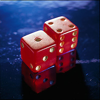 Red dice on blue background<br />
