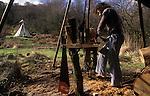 TeePee Valley near LLandeilo Wales UK. Alternative Life style Circa 1985.<br /> <br /> Ferret Steve using a  Pole Lathe