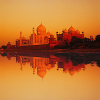 Taj Mahal, Agra, India, seen reflected in the River Yamuna.  Built between 1631 and 1648 it was Shah Jahan's monument to Mumtaz Mahal his favourite/favorite wife.  Digital composite.