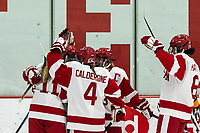 BOSTON, MA - JANUARY 04: Goal celebration. Mackenna Parker #11 of Boston University celebrates her goal with teammates during a game between University of Maine and Boston University at Walter Brown Arena on January 04, 2020 in Boston, Massachusetts.