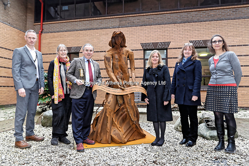 """Pictured: (L-R) Martin Thomas ABMU Heritage Lead, Phil Thimbleby, Arts Health co-ordinator, Andrew davies ABMU Chairman, artist Sarah Tombs, Fiona Edwards and Heather Parnell, both ABMU Arts and Health team. Monday 05 February 2018<br /> Re: A sculpture has been unveiled at Welsh Centre for Burns and Plastic Surgery in Morriston Hospital to commemorate its links with Port Talbot steelworks in Wales, UK.<br /> It was inspired by Welsh mythology and created from Tata steel by artist Sarah Tombs.<br /> The sculpture is of the legendary Lady of Llyn y Fan Fach and was unveiled by Abertawe Bro Morgannwg health board to mark the 70th birthday of the NHS.<br /> According to the Mabinogion and The Red Book of Hergest, she was mother of the Physicians of Myddfai, who used magical powers to heal the sick and symbolises """"regeneration and healing""""."""