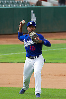 Yensys Capellan (10) of the Ogden Raptors on defense against the Orem Owlz in Pioneer League action at Lindquist Field on June 27, 2014 in Ogden, Utah.  (Stephen Smith/Four Seam Images)