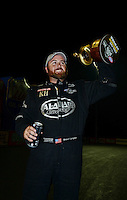Sept. 16, 2012; Concord, NC, USA: NHRA top fuel dragster driver Shawn Langdon celebrates after winning the O'Reilly Auto Parts Nationals at zMax Dragway. Mandatory Credit: Mark J. Rebilas-
