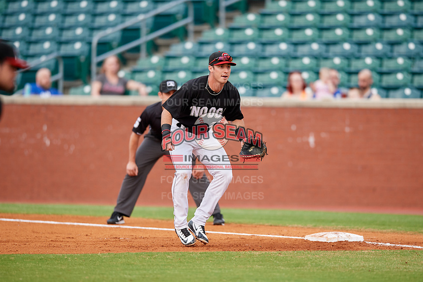 Chattanooga Lookouts first baseman Brent Rooker (25) in front of first base umpire Anthony Perez during a game against the Jackson Generals on May 9, 2018 at AT&T Field in Chattanooga, Tennessee.  Chattanooga defeated Jackson 4-2.  (Mike Janes/Four Seam Images)