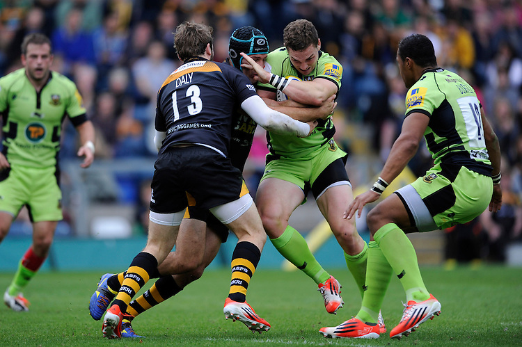 George North of Northampton Saints is tackled by Elliot Daly and Chris Bell of Wasps during the Premiership Rugby Round 2 match between Wasps and Northampton Saints at Adams Park on Sunday 14th September 2014 (Photo by Rob Munro)