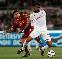 Calcio, Serie A: Roma-Milan. Roma, stadio Olimpico, 7 maggio 2011..Football, Italian serie A: AS Roma vs AC Milan. Rome, Olympic stadium, 7 may 2011..AC Milan midfielder Kevin Prince Boateng, of Germany, right, is challenged by AS Roma midfielder David Pizarro, of Chile..UPDATE IMAGES PRESS/Riccardo De Luca
