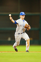 Shortstop Taylor Black #5 of the Kentucky Wildcats makes a throw to first base against the Rice Owls at Minute Maid Park on March 4, 2011 in Houston, Texas.  Photo by Brian Westerholt / Four Seam Images