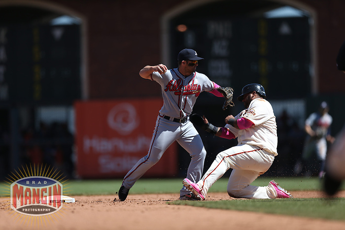 SAN FRANCISCO, CA - MAY 12:  Dan Uggla #26 of the Atlanta Braves is taken out at second base by a sliding Pablo Sandoval #48 of the San Francisco Giants during the game at AT&T Park on Sunday, May 12, 2013 in San Francisco, California. Photo by Brad Mangin