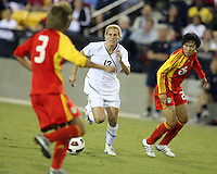 Kristine Lilly #13 of the USA WNT breaks between Fan Yu #3 and Nan Zhang #26 of the PRC WNT during an international friendly match at KSU Soccer Stadium, on October 2 2010 in Kennesaw, Georgia. USA won 2-1.
