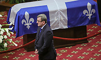 Quebec City mayor Regis Labeaume gives his condolences to Lisette Lapointe, wife of former Quebec premier Jacques Parizeau, as her husband lies in state at the National Assembly in Quebec City on Sunday June 7, 2015.<br /> <br /> PHOTO :  Francis Vachon - Agence Quebec Presse