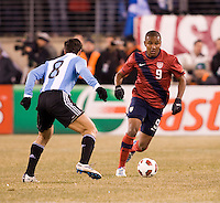 Juan Agudelo (9) of the United States brings the ball up towards Javier Zanetti (8) of Argentina during an international friendly at New Meadowlands Stadium in East Rutherford, NJ.  The United States tied Argentina, 1-1.