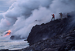 Photographers filming Lava flowing into the Pacific Ocean, Hawaii Volcanoes National Park, Hawaii