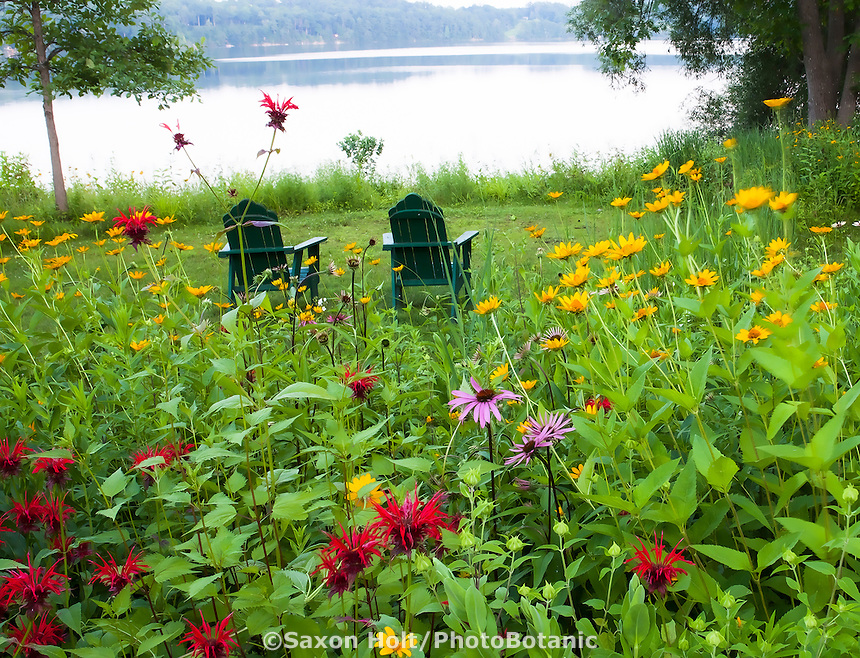 Chairs overlooking lake in Connecticut meadow garden with native wildflowers; Larry Weaner Design