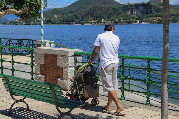 Father pushing stroller along Lake Maggiore, in Arona, Italy .  John offers private photo tours in Denver, Boulder and throughout Colorado, USA.  Year-round. .  John offers private photo tours in Denver, Boulder and throughout Colorado. Year-round.