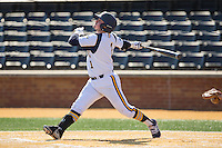 Julius Saporito (1) of the Quinnipiac Bobcats follows through on his swing Radford Highlanders at David F. Couch Ballpark on March 4, 2017 in Winston-Salem, North Carolina.  The Highlanders defeated the Bobcats 4-0.  (Brian Westerholt/Four Seam Images)