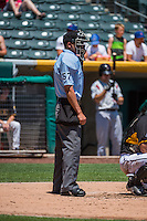 Umpire Roberto Ortiz handles the calls behind the plate during the Pacific Coast League game between the Salt Lake Bees and the Albuquerque Isotopes at Smith's Ballpark on June 28, 2015 in Salt Lake City, Utah. The Isotopes defeated the Bees 8-3. (Stephen Smith/Four Seam Images)
