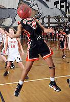 Charlottesville Shalita Brown reaches for the rebound against Brentsville. Photo/Andrew