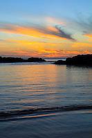 A beautiful sunset reflected in the ocean at Ko Olina, O'ahu.