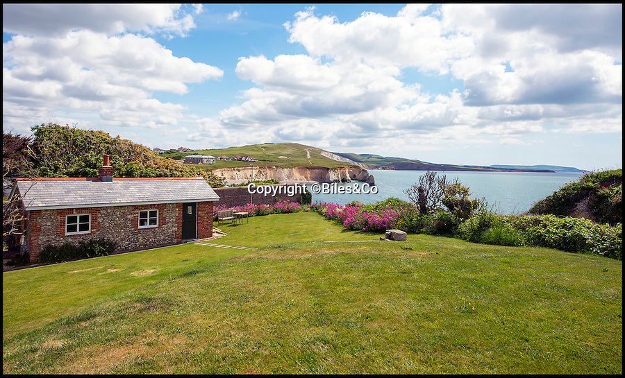 BNPS.co.uk (01202 558833)<br /> Pic: Biles&Co/BNPS<br /> <br /> Stunning views - Impregnable privacy.<br /> <br /> Security won't be a worry with this stunning property - a 160-year-old former fort built to defend the Isle of Wight from the threat of the French Navy.<br /> <br /> The once-functional military building is now a beautiful home perched on a cliff with one of Britain's best coastal views.<br /> <br /> Freshwater Redoubt still has its old ramparts, tunnels and gun emplacements, as well as a helicopter landing pad and its own beach which is only accessible by boat or at low tide. It is on the market for £3m.