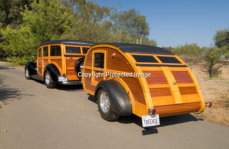 1940 Ford Deluxe Woody towing a 1948 homebuilt teardrop remodeled into a Woody style vintage travel trailer.