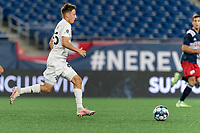 FOXBOROUGH, MA - JULY 23: Antonio Carlini #85 of Toronto FC II brings the ball forward during a game between Toronto FC II and New England Revolution II at Gillette Stadium on July 23, 2021 in Foxborough, Massachusetts.