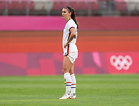 KASHIMA, JAPAN - JULY 27: Alex Morgan #13 of the USWNT stands on the field during a game between Australia and USWNT at Ibaraki Kashima Stadium on July 27, 2021 in Kashima, Japan.