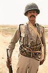 Marsh Arabs. Southern Iraq. 1984 Marsh Arab  soldier with gun belts.
